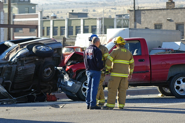 """""""firemen in front of vehicle crash with red pickup truck"""""""