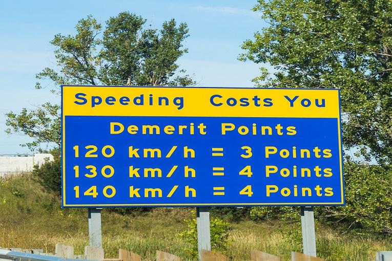 """""""Speeding demerit points sign,  120 km/h = 3 points, 130 km/h = 4 points, 140 km/h = 4 points"""""""