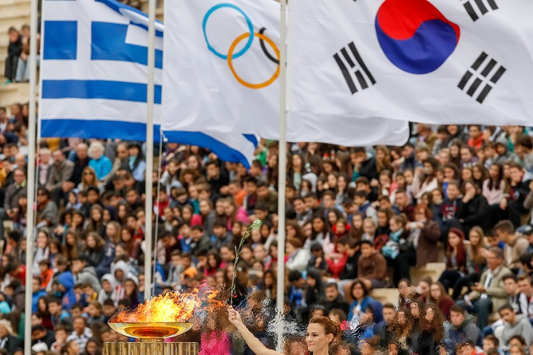 """""""woman at olympics holding flags"""""""