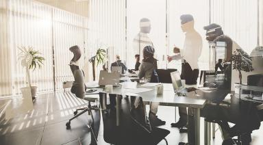 People sitting around a table in a meeting room